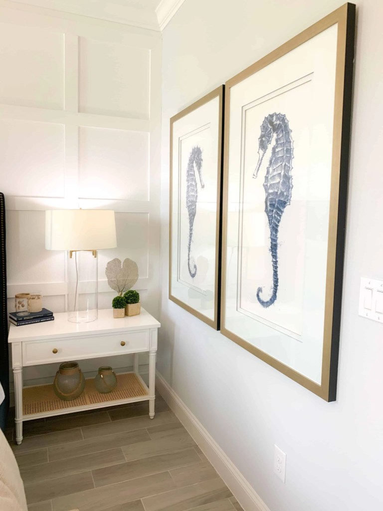 Seahorse wall art in master bedroom