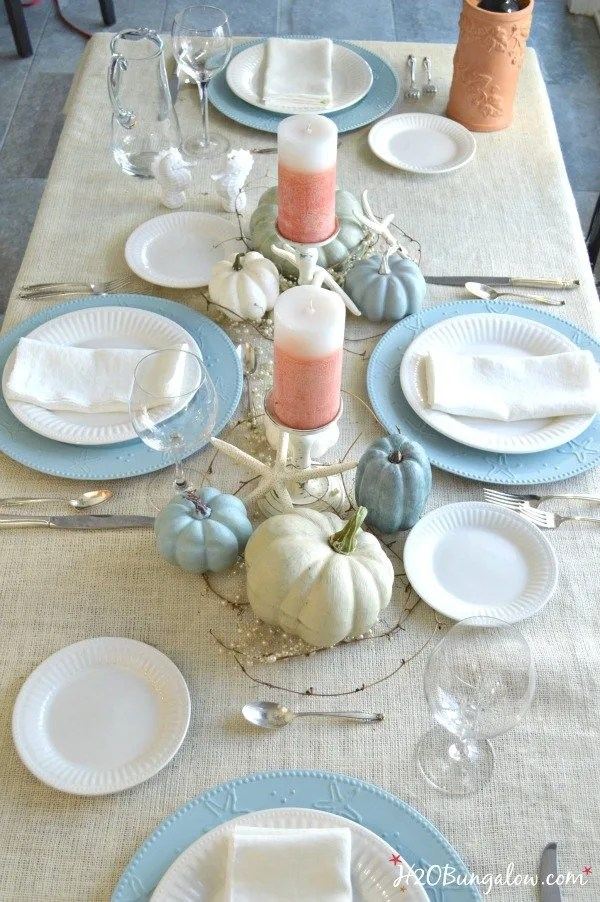 Coral and muted blue accents on this coastal fall table