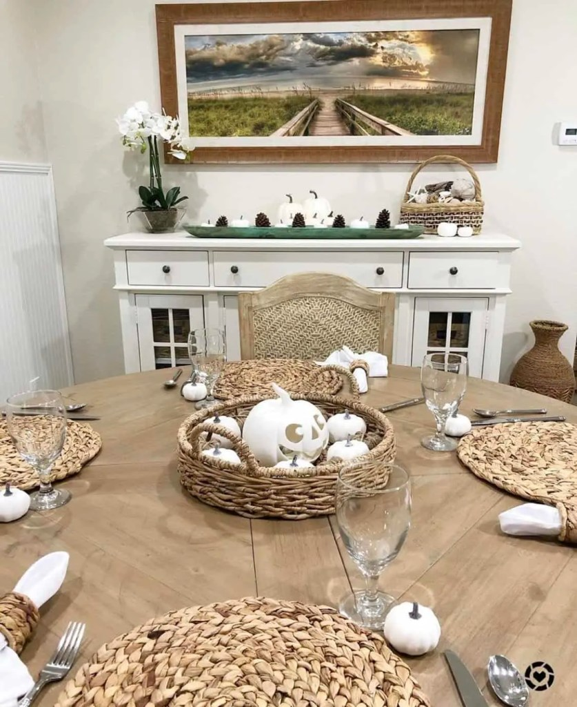 Light Wood Table With White Fall Thanksgiving Accents