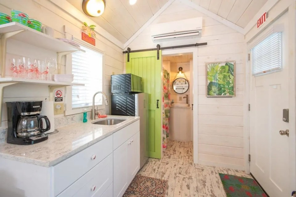 Lime Green Barn Door Airy Tiny Home White Washed Wood Design