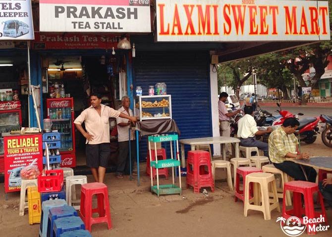 Mapusa Bus Stand in Goa showing a little Indian shop and tea stall with plastic stools