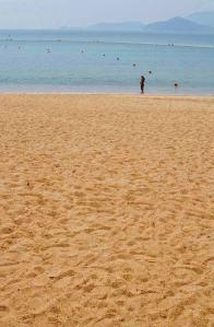 Repulse Bay Beach with a girl bathing in the sea enclosed by buoys at Repulse Bay, Hong Kong