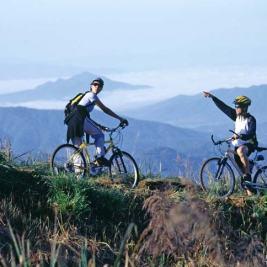 Two mountain-bikers in a beautiful rural mountain setting