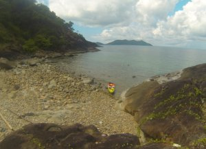Kayak laying at the shore of a rocky beach in southern Koh Chang