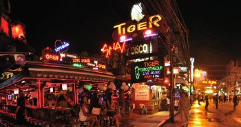 Tiger Disco on Bangla Road in Patong City at night with neon lights and bar girls.