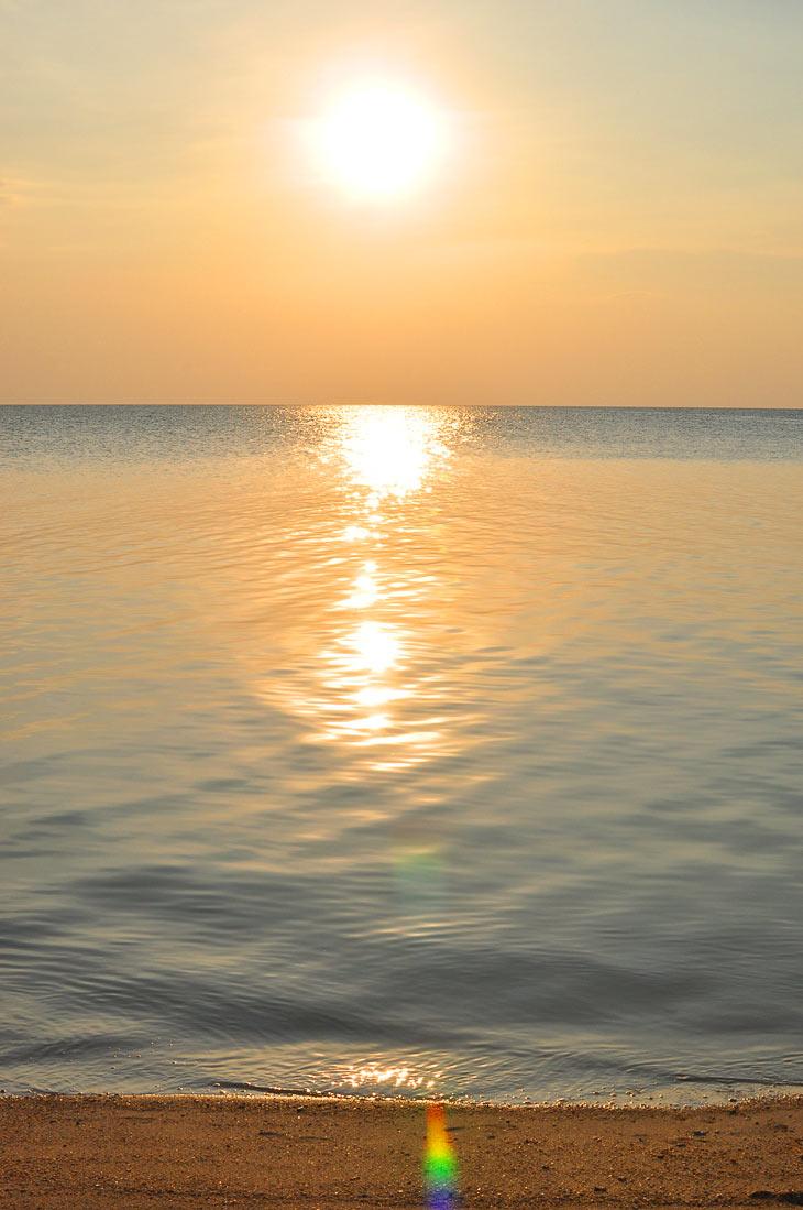 Mesmerizing sunset with sun light reflection at Selingan Island in Malaysian Borneo.