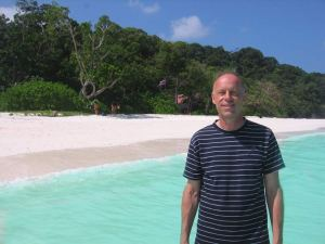 Man posing on the beach on Koh Tachai in Thailand