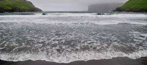 Faroe Islands beach with black sand color due to volcanic sediments
