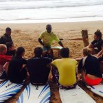 surfing instructor giving surf lesson in Busua, Ghana