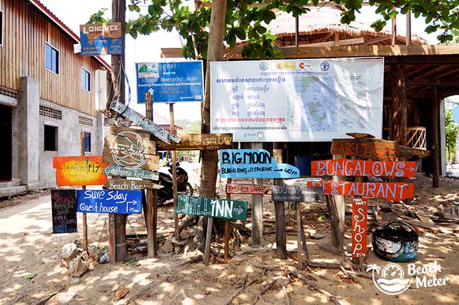 Accommodation and restaurant signs from M'Pay Bay Village, Koh Rong Samloem. © Beachmeter.com