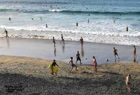 dark sand beach activity in Canary Islands