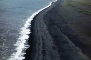black sand beach New Zealand bird's view