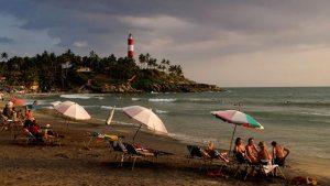 Tourists enjoying Kovalam Beach in India