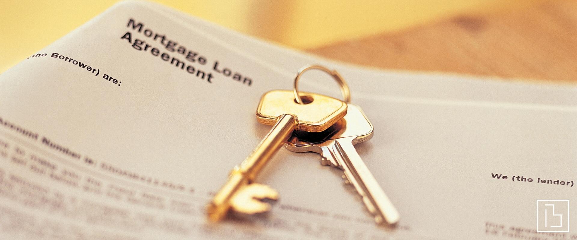 Set of keys on top of a mortgage document - Beachworks LLC