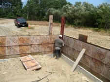 July 21, 2011 Putting up forms for walls on footers.