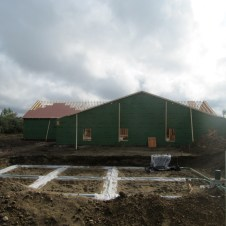 9/29/11 View from road--septic system and gable end of Sunday School wing.