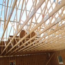 9/30/11 View of trusses from inside as the boards are going up.