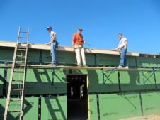 10/10/11 Devan, Gordon Johnston, & Terry putting up fascia board.