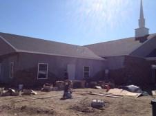 3/20/12 Chris & Mason Kairnes, Pastor Bill & Gordon putting up stone
