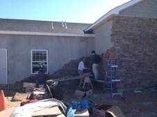 3/20/12 Gordon & Tai-yo Johnston putting up stone.