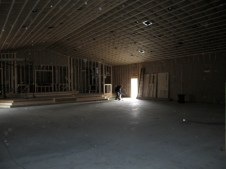 3/9/12 Another view of the insulated auditorium and Gordon cleaning it up.