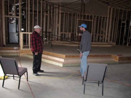 3/13/12 Ray Warner & Pastor Bill figuring out chair layout.
