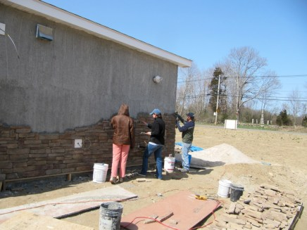 3/26/12 Hannah, Michaela, & Chris working on the back of the church.
