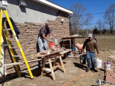 4/3/12 Ed Verra laying stone, Gordon carrying mortar