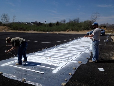 4/16/12 Pastor Bill and Bro. Terry spraying the frames for the doors.