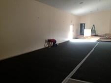 4/26/12 Brian Miller stapling the carpet down in the auditorium