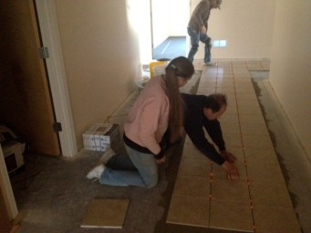 4/28/12 Gary showing Hannah how to space the tiles