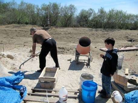4/18/12 Ray Warner showing Jake how to sift the sand for the mortar.