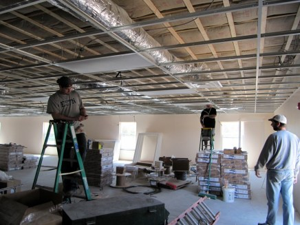 4/18/12 Electricians installing lights in fellowship hall