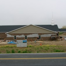 5/4/12 view from road–the last of the stonework to be done is seen here.