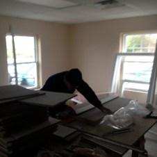 5/1/12 Luke cutting ceiling tiles; Peter & Anna installing them