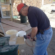 5/7/12 Bro. Tommy cutting the tile