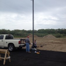 5/15/12 Tommy Goodfellow and Lenny the electrician installing a parking lot light.