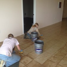 5/22/12 Hannah & Anna scrubbing the grout off the tiles