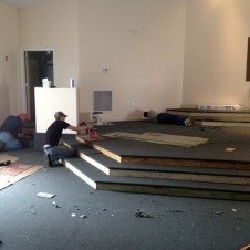 5/26/12 Mr. Goodfellow and Brannon Miller gluing carpet on the stage