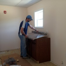 5/31/12 Pastor Bill installing the cabinets