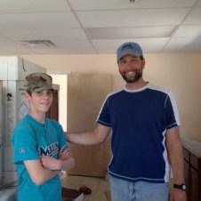 5/31/12 Devan & Pastor Bill working in the kitchen