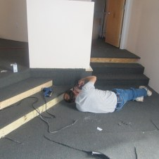 5/26/12 Gary gluing carpet on the stairs