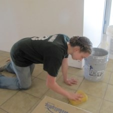 5/26/12 Hannah washing the grout off tile