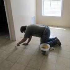 5/26/12 Frank Brazee staining the grout