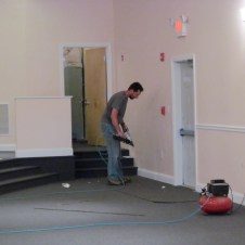 7/7/12 Pastor Bill putting on baseboards
