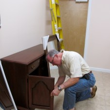 7/7/12 Tommy Goodfellow fixing the ladies' bathroom cabinet