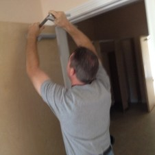 6/30/12 Pastor Terry installing door closers
