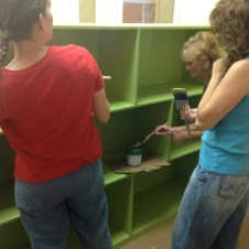 7/10/12 Gaye Nobles from Bethel FWB Church in Woodbridge putting the finish coat on the nursery shelf