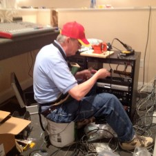 7/13/12 Pastor Nobles working on the sound system wiring
