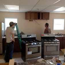 7/14/12 Brannon & Pastor Terry working on installing appliances